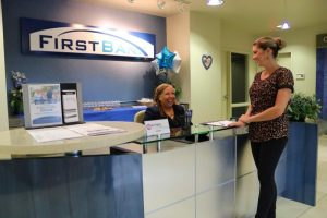 First Bank employee sharing a chat with a guest